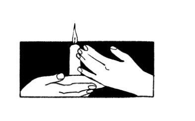 dve roki držita svečo